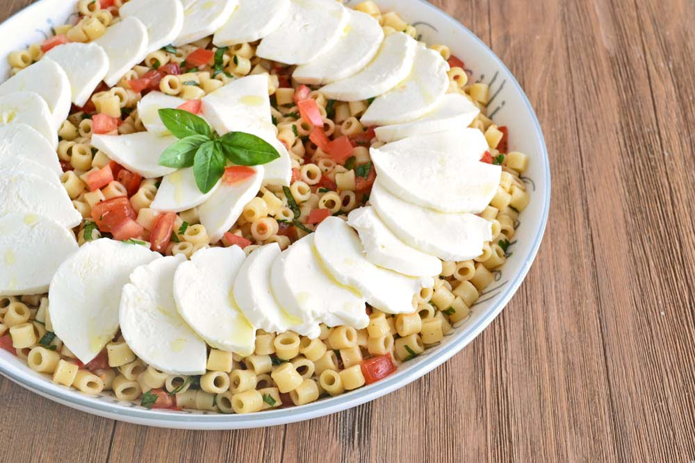 Make-Ahead Caprese Pasta Salad Recipe - An easy, affordable side dish recipe on COOKtheSTORY.com