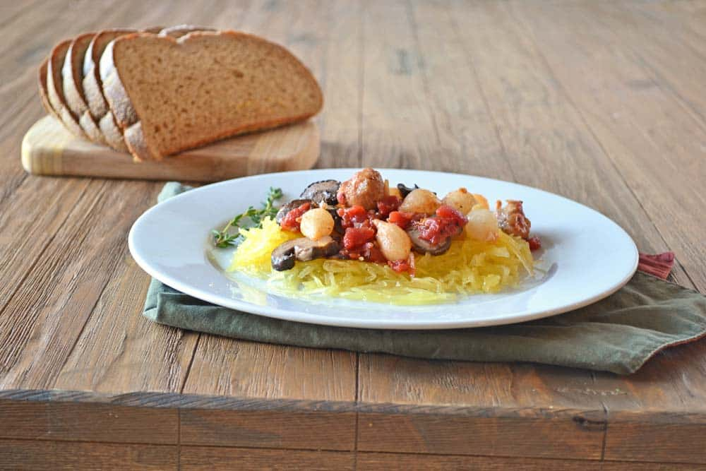 One of my favorite quick meals: Sausage with Vegetables over Spaghetti Squash - get the recipe at COOKtheSTORY.com