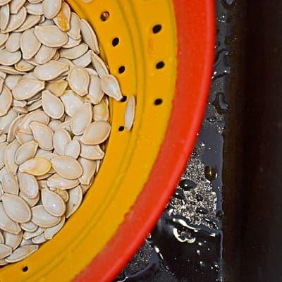 Pumpkin seeds in a colander.