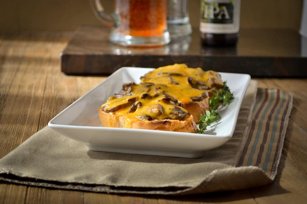Welsh Rarebit Recipe - A take on a traditional rarebit recipe, this is a less messy appetizer that you can eat with your fingers.