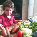 J and the vegetables from our organics box. My chat with Angela and Katie abotu Flexitarianism convinced me to start focusing on veggies. This is where we'll start!