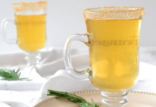 Hot Apple Cider Recipe, jazzed up with fresh rosemary and whiskey for the grown-ups in the crowd. A great holiday drink!