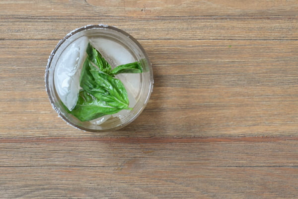 A glass that once contained a Lemon and Basil Margarita. Now it's empty. Time for another round! By @cookthestory