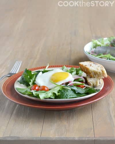 A warm salad topped with a fried egg for brunch or a light vegetarian entree - recipe by @cookthestory