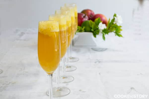 A delicious drink recipe for brunch! Mango Lime Bellinis by @cookthestory for #BrunchWeek