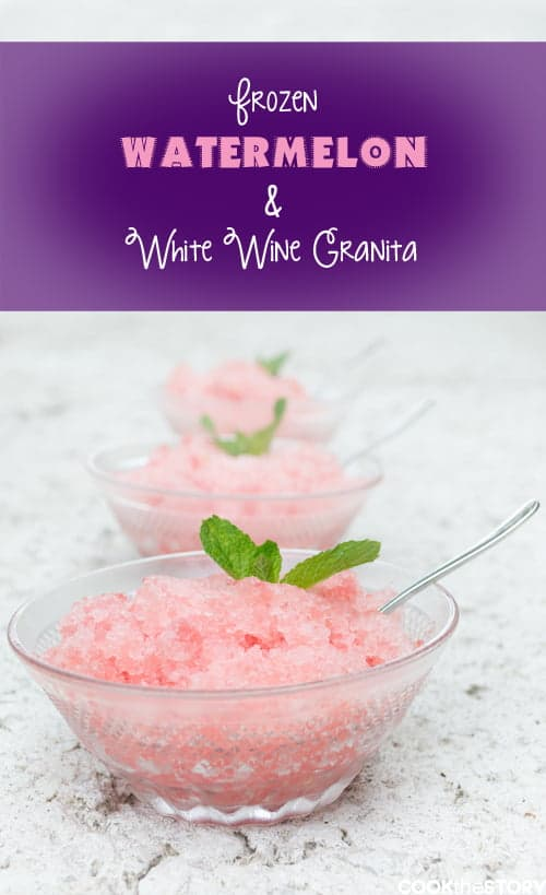 Pink shaved ice in a small glass bowl with a sprig of mint and a spoon in the bowl. There are two more bowls of pink ice behind it.