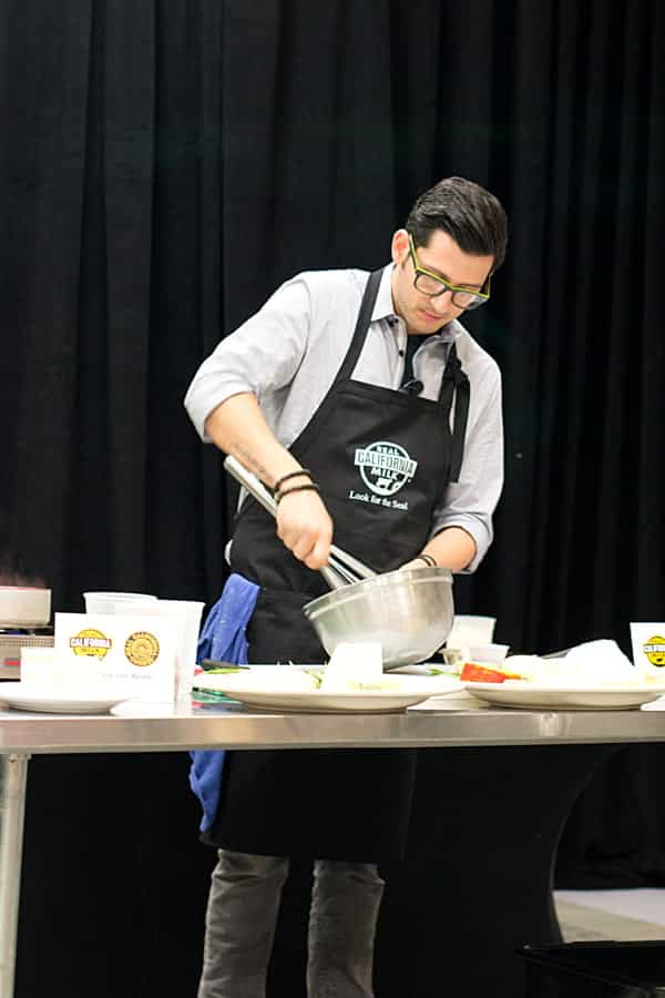 Chef Giorgio Rapicavoli whipping up a tasty treat at the Hispanic Dairy Cooking Demo put on by the California Milk Advisory Board during BlogHer Food.