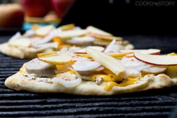 Grilled pizza with apples and sausage