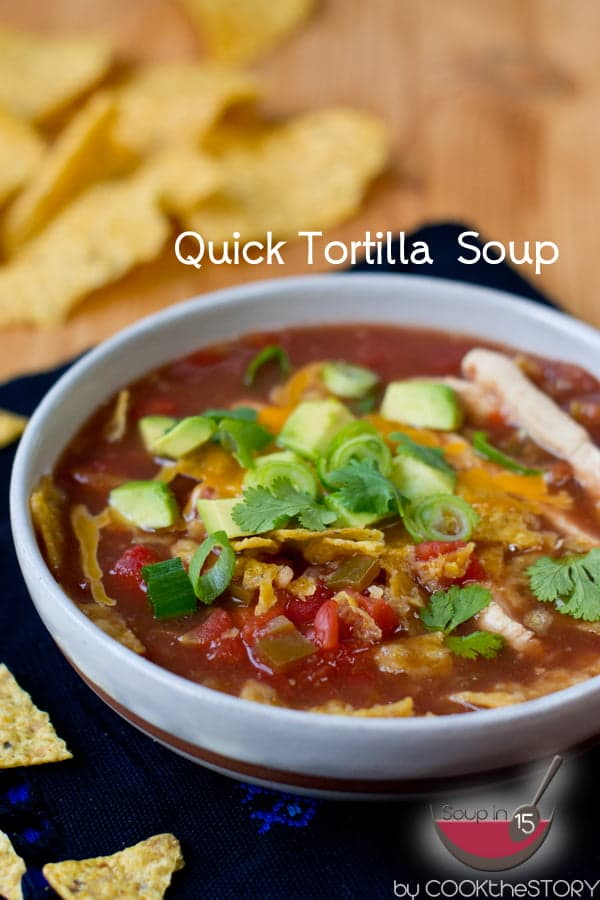 Quick Chicken Tortilla Soup in bowl with tortilla chips in background.