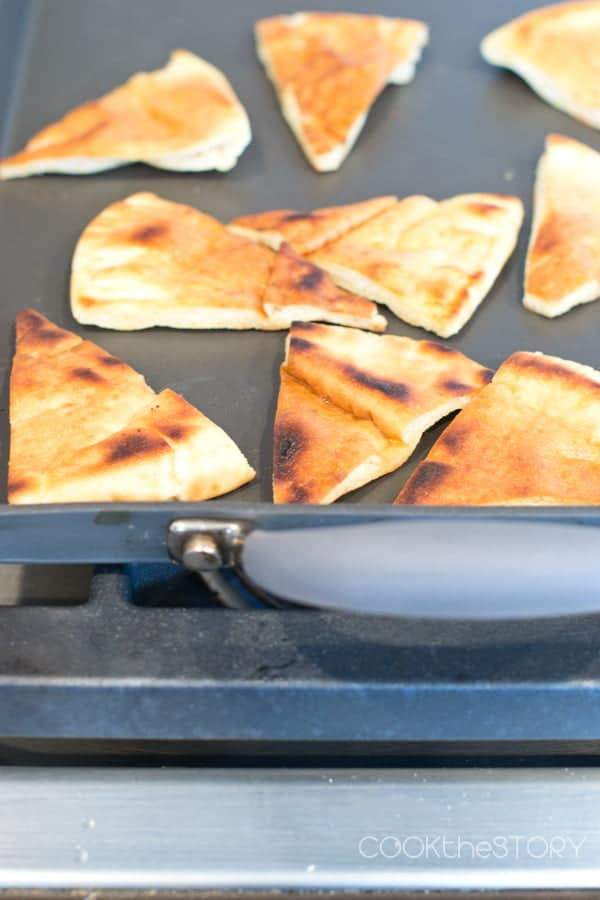 Toasting Pita Chips on Anolon Advanced Double Burner Griddle for Kalamata Hummus Recipe with Homemade Pita Chips