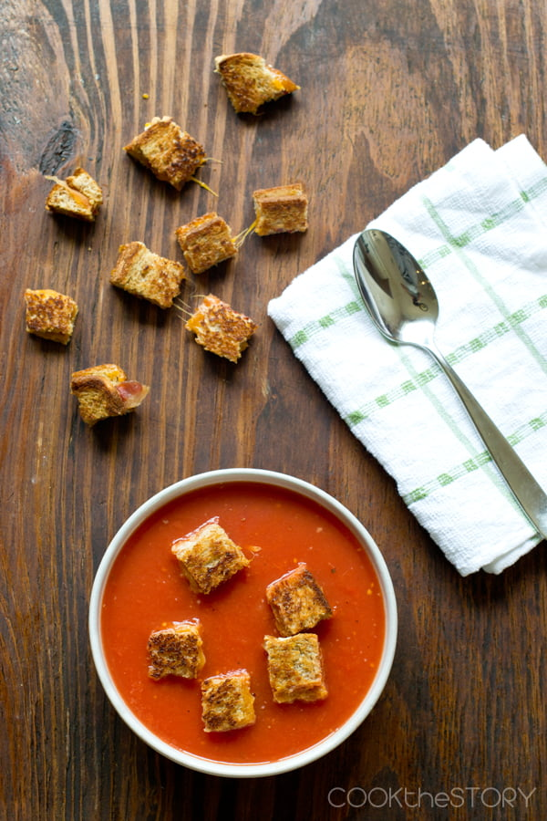 Tomato Soup with Grilled Cheese and Bacon Croutons - Get the recipe from CookTheStory.com